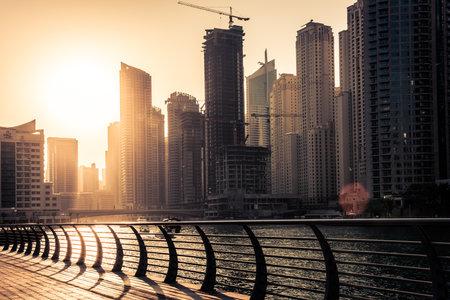 december 31: UAE, DUBAI - DECEMBER 31: Skyscrapers silhuette at sunset in Dubai marina on December 31, 2014. Contre jour shot Editorial