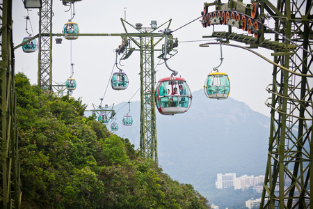 01: HONG KONG, HONG KONG - OCTOBER 01: cable cars over tropical trees in Hong Kong on October 01, 2012 Editorial