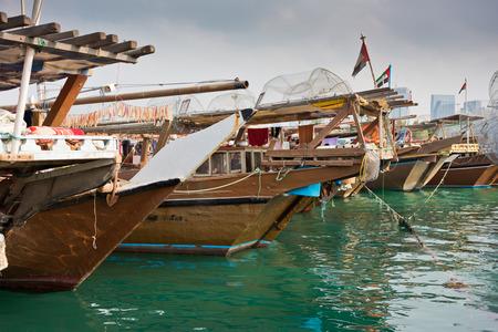 Old fishing boats in Abu Dhabi, UAE. Overcast day Stock Photo