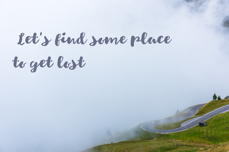 let s: Inspiring quote Let s find some place to get lost on picture of mountains road in overcast foggy weather
