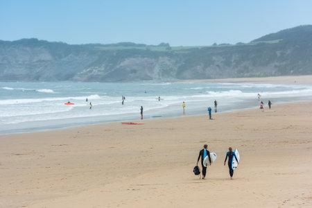surfers: FRANCE, HENDAYE - SEPTEMBER 17: Surfers walking together towards the ocean on September 17, 2015