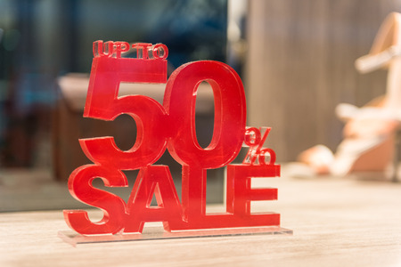 shop window: Sale signs with big reductions in shop window