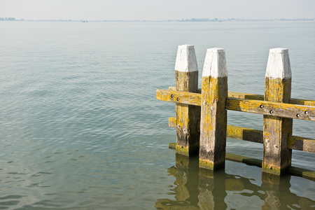still water: Northern Sea landscape: still water and wooden pier