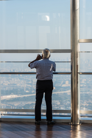top of the world: DUBAI, UAE - JANUARY 02: people at the top the observation deck of the highest building in the world Burj al Khalifa on January 02, 2015 in Dubai, United Arab Emirates Editorial