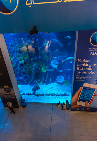 december 25: UAE, DUBAI - DECEMBER 25: huge aquarium in Dubai Mall shopping center on December 25, 2014 Editorial