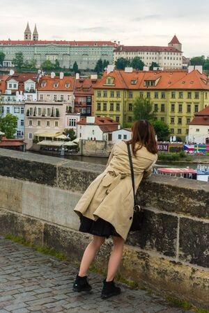 czech women: THE CZECH REPUBLIC, PRAGUE - MAY 19: Woman is taking pictures on the Charles bridge in Prague, Czech on May 19, 2015 Editorial
