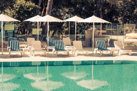 filtered: Hotel Poolside Chairs with Sea view. Filtered shot