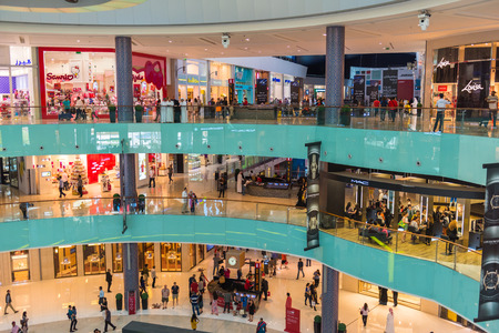 december 25: UAE, DUBAI - DECEMBER 25: people do shopping in Dubai Mall store center on December 25, 2014 Editorial