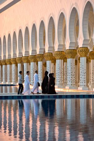 december 21: UAE, ABU DHABI - DECEMBER 21: Beautiful gallery of famous Sheikh Zayed White Mosque on December 21, 2014