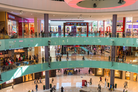 december 25: UAE, DUBAI - DECEMBER 25: people do shopping in Dubai Mall store center on December 25, 2014 Editorial