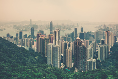 filtered: Haze Hong Kong downtown view from Victoria peak. Filtered shot