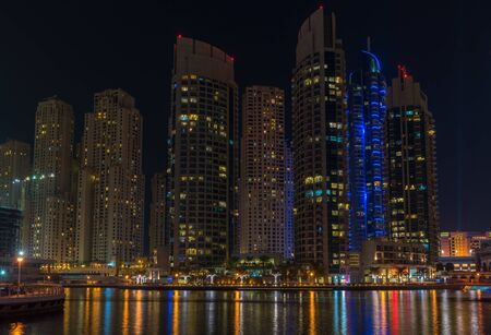 december 31: UAE, DUBAI - DECEMBER 31: night view of Dubai Marina, United Arab Emirates - the largest man-made marina in the world on December 31, 2014