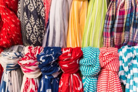 fringes: Selection of colorful women scarves at a market