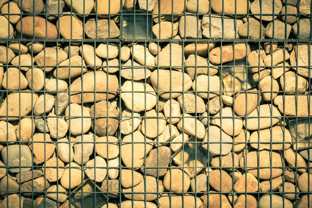 gabion: metallic basket net filled by natural stones as a fence