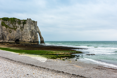 manche: The beach and stone cliffs in Etretat, France, Normandy