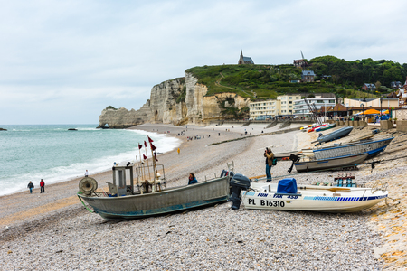 FRANCE, ETRETAT - MAY 29: view of the beach and fishing boats in Etretat, France on May 29, 2015. Bad weather