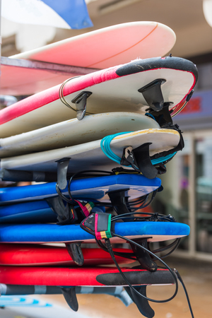 set of different color surf boards in a stack. France