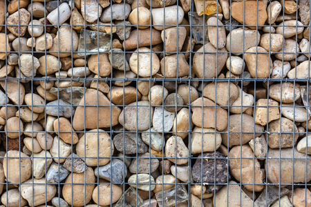 gabion mesh: metallic basket net filled by natural stones as a fence