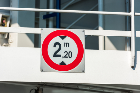 restriction: Traffic sign of height restriction at the entrance to the ferryboat