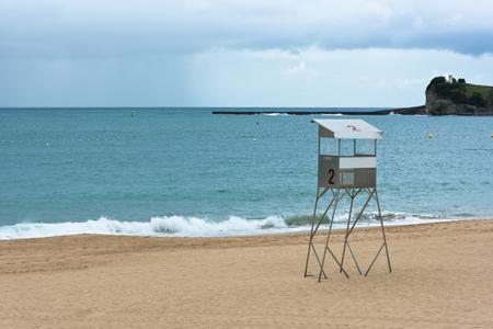 inclement weather: Saint-Jean-de-Luz sand beach in France. Rainy weather