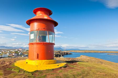 Red Lighthouse above Stykkisholmur, Snaefellsnes peninsula, the western part of Iceland