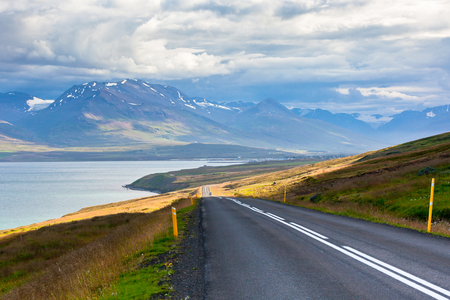 Endless Highway through Icelandic landscape. Seaside road
