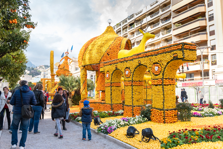 menton: FRANCE, MENTON - FEBRUARY 18: 84th Lemon Festival (Fete du Citron) in Menton town on the French Riviera. Huge citrus constructions made from lemons and oranges on Broadway theme on February 18, 2017 Editorial