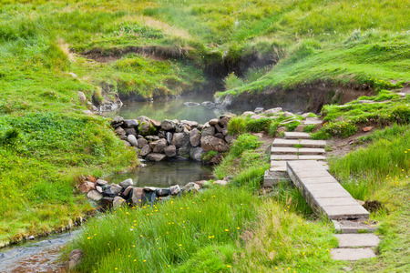 Hot spring outdoor bath in Iceland. Nordic calm nature