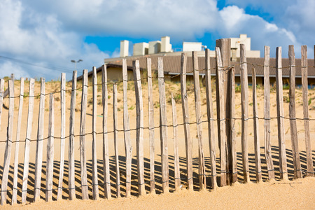 gironde department: Wooden fence on an Atlantic beach in France, The Gironde Department. Shot with a selective focus