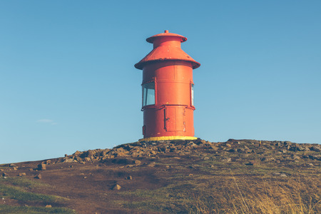 Red Lighthouse on a hill above Stykkisholmur, the western part of Iceland Stock Photo