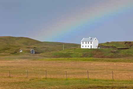 South Icelandic landscape with a house and rainbow