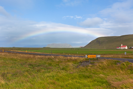 South Icelandic landscape with a church and rainbow Stock Photo