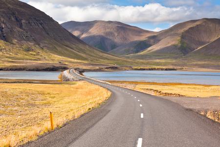 Endless Highway through Icelandic landscape. Seaside road