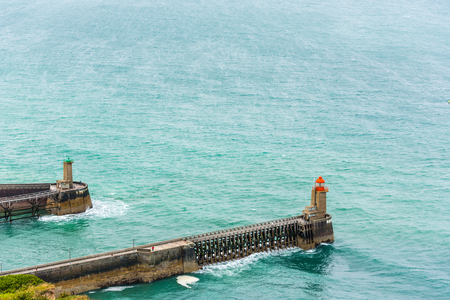 View of an Old Pier with lighthouses in Fecamp, France Stock Photo