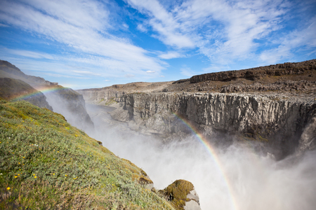 Dettifoss Waterfall in Iceland under a blue summer sky with clouds. Horizontal shot Stock Photo