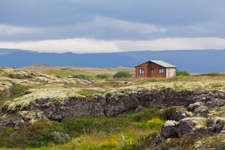 Small wooden cottage in Iceland volcanic landscape Stock Photo