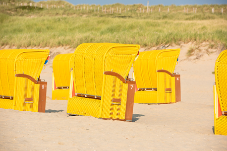 Beach wicker chairs strandkorb in Northern Germany Stock Photo