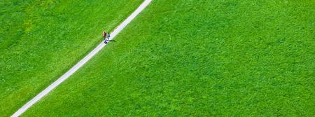 Walking footpath in green field. Long wide banner