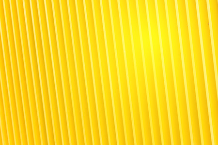 Detail of bright yellow metal building facade. For background