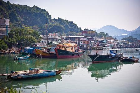HONG KONG, HONG KONG - OCTOBER 02: Fishing village with floating boats in Hong Kong on October 02, 2012