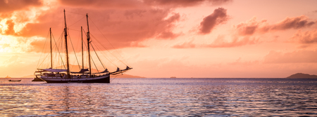 Recreational Yacht at the Indian Ocean. Beautiful sunset. Long wide banner Stock Photo