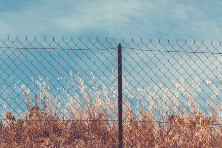 Razor and barbed wire fence. Forbidden place