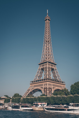 The Eiffel tower and the Seine river with blue clear sky in background Paris France