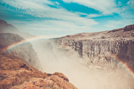 Dettifoss Waterfall in Iceland under a blue summer sky with clouds. Horizontal shot Imagens