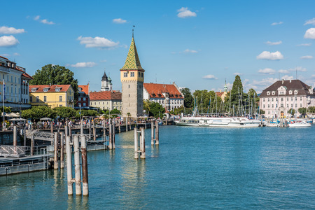 GERMANY, LINDAU - AUGUST 21: view of the Mangturm tower, the embankment and port of Lindau at lake Constance, Bodensee on August 21, 2015 Editorial