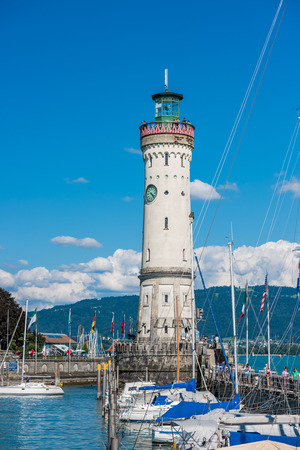 GERMANY, LINDAU - AUGUST 21: view of the lighthouse and a lion statue at the entrance to the port of Lindau at lake Constance, Bodensee on August 21, 2015