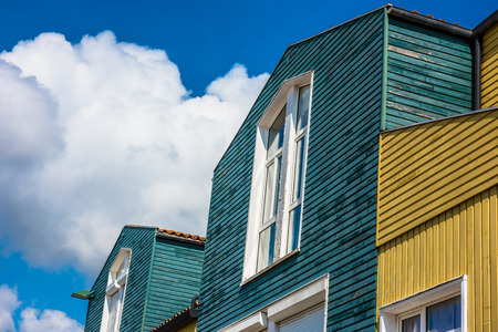 Bright colorful houses on the seaside street in the port of La Rochelle, France