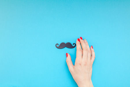Creative flatlay top view retro black paper photo booth props moustaches woman hands turquoise background copy space. Stock Photo