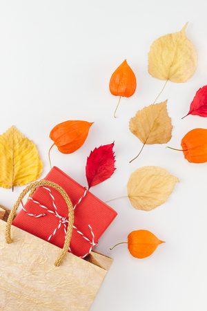 Creative Top view flat lay autumn composition Shopping bag dried orange flowers leaves background copy space Template sale mockup fall harvest thanksgiving halloween promotion flyers Stock Photo