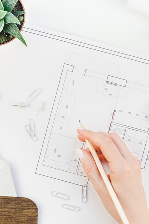 Creative flat lay overhead top view blueprints architectural flat project plan and office supplies on decorator white table workspace with swatches tools and equipment background copy space concept 版權商用圖片